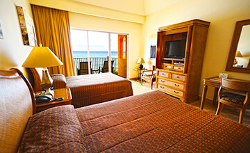 ample junior suite with double beds